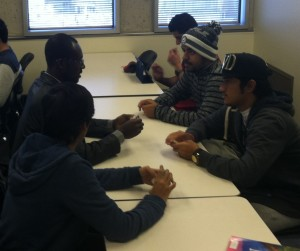 Augustin Palenfo (Burkina Faso) helps students practice vocabulary skills with NKU students.
